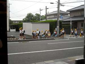 The Elementary age kids in Japan walk to school this way